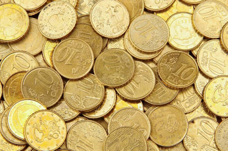 numismatics: Pile of 10 cents euro euro coins for background