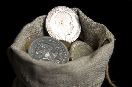 Reich: Five mark coin of German reich in sack bag isolated on black