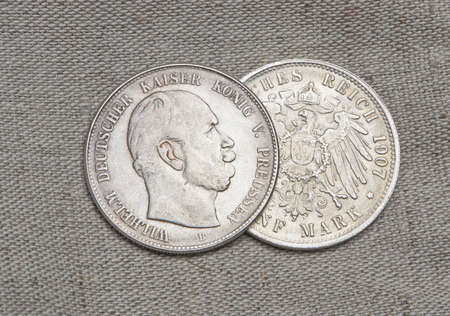 Reich: Old silver coins of German reich over sack
