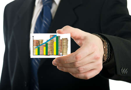 Businessman showing card with stack of euro coins and prediction chart photo
