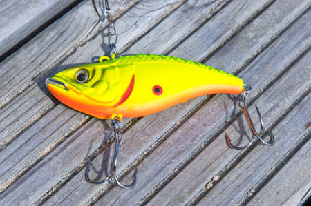 spinner: Yellow fishing lure close up Stock Photo
