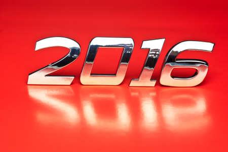 metallic: Metallic number 2016 over red background