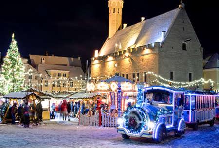 christmas train: Christmas train near christmas market in old city of  Tallinn, Estonia Stock Photo