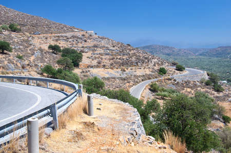 Winding road in mountains of Crete island, Greece Banco de Imagens