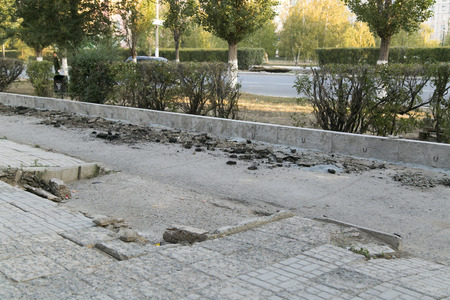 The repair of the road. Pictures of repairing of pedestrian sidewalk. Setting the border