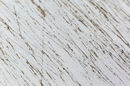 The texture of the rugged cardboard is macro. The tree is cut with a sharp knife into small strips