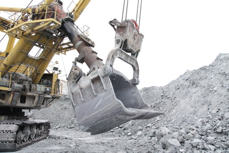 Bucket excavator volume of 10 meters cubic. A close-up of a bucket of a large excavator in a quarry. Banco de Imagens