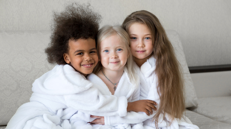 Children of different religions hug each other. Girls of different faiths and women are happy together.