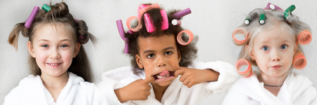 Little girls make hair curls collage. Girls in white coats with hair curlers in hair collage of three people.