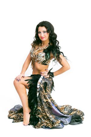 Girl dancer oriental dance. Isolated. Brunette woman Foto de archivo