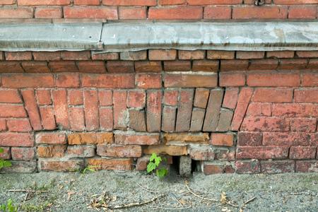 Old brick wall. Boulder rows.