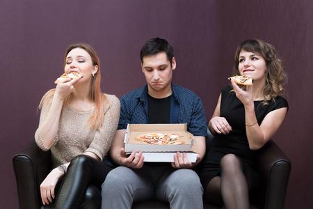 pizza jealous girls. Man dieting looks like girlfriends eat pizza.
