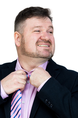 A man tears his tie around his neck. Angry fat man with a beard stretch removes hair from his neck.