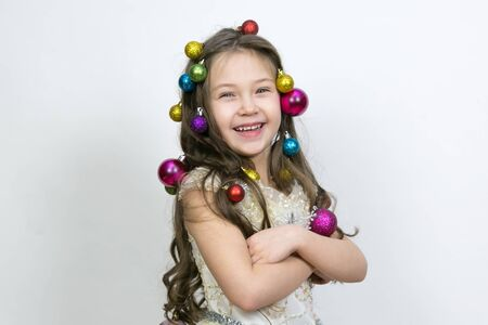 The girl experiences happiness from the coming Christmas. The joy of the child from the New Year holidays. Stock Photo - 132124189