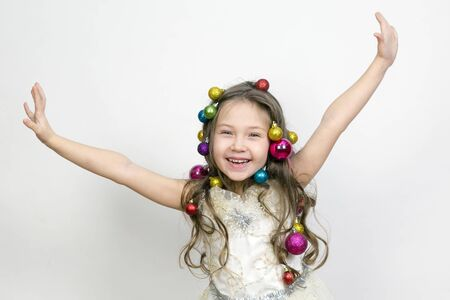 The joy of the child from the New Year holidays. The girl experiences happiness from coming Christmas