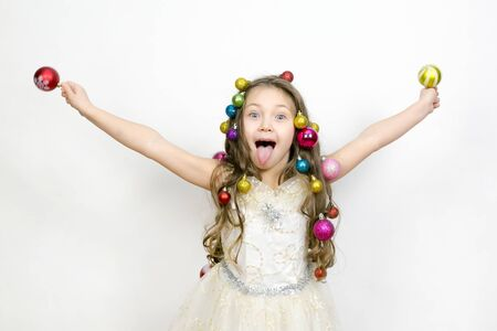 The joy of the child from the New Year holidays. girl experiences happiness from the coming Christmas. Stock Photo - 132123983