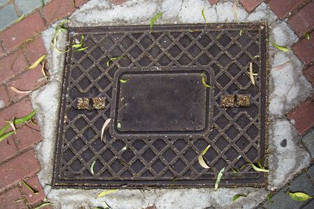 The technical hatch of city drains and sewers is rectangular.