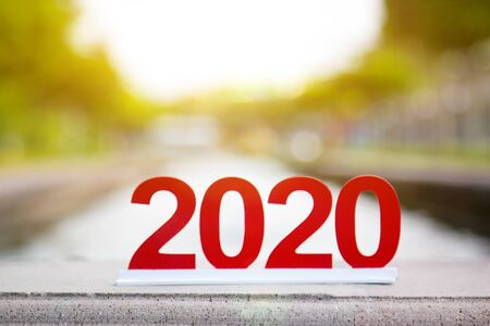 Digit 2020 at the city fountain Figures 2020 are symbol of the coming year on the edge of the fountain fence on the street