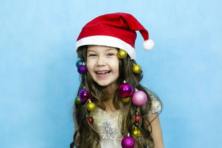 Girl experiences happiness coming Christmas. The joy of the child from the New Year holidays.