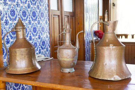 Antique copper cookware at the hotel. Ancient kitchen utensils displayed at the Turkish hotel for tourists.
