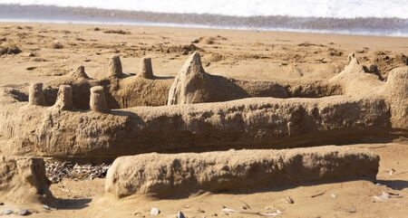 Sand castle on the beach. The sand palace was built by children on sea coast