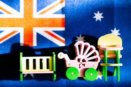 Maternity and childbirth in the Australia. Fertility and population growth in United Kingdom, childrens furniture against the backdrop of the flag of Australia Reklamní fotografie