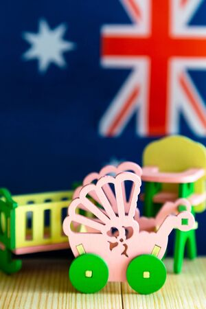 Maternity and childbirth in the Australia. Fertility and population growth in the United Kingdom, childrens furniture against the backdrop of the flag of Australia Reklamní fotografie