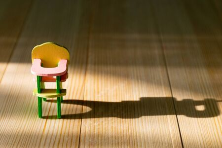 Infertility concept, lack of children in the family, empty highchair Stock Photo