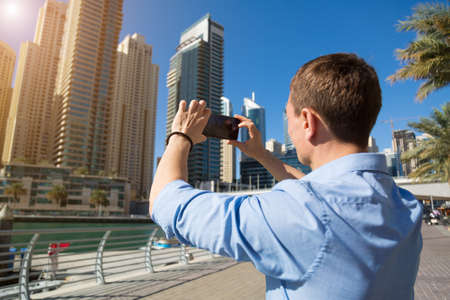 A man photographs local attractions of the country.