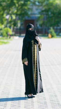 Oriental girl in festive national dress in European city