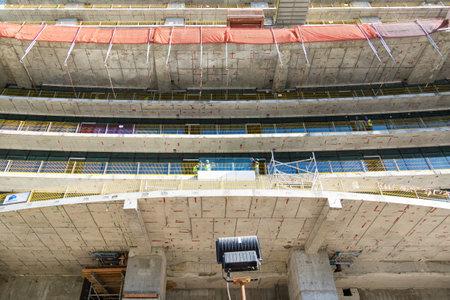 Dubai, United Arab Emirates 03 03 2020: Building construction. editorial Construction work on a tall building, bottom view. Editoriali