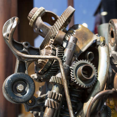 Robot made of metal parts and assemblies. Metal components and parts are arranged in the shape of a robot