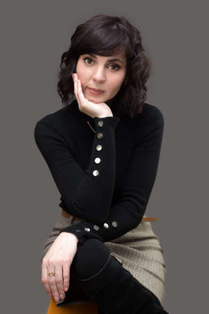 Adult woman in black sweater with short hair. Standard-Bild