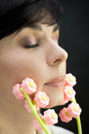 Roller massager on female face skin rejuvenation. 版權商用圖片