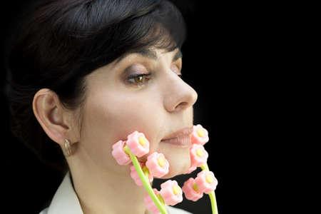 Roller massager on female face, skin rejuvenation.