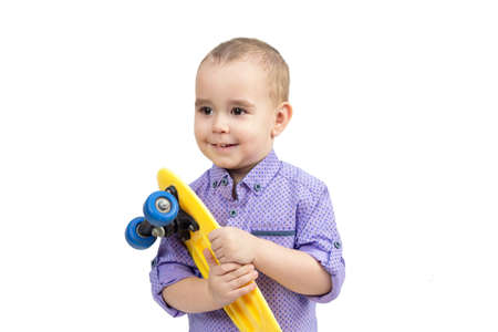 Child with skateboard in hands isolate white background.