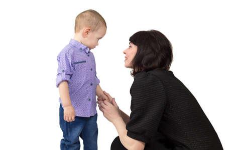 Mom calms her upset little son. Isolate, white background 版權商用圖片