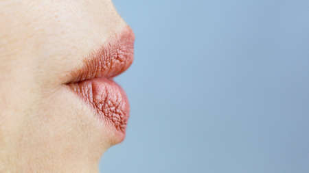 Women's lips are stretched out into tube like a duck.