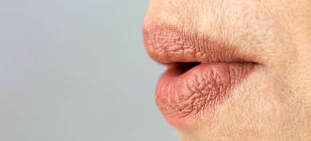Women's lips are stretched out into a tube like a duck.