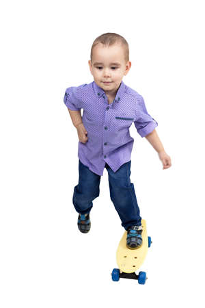 Little boy riding a skateboard isolated, White background.