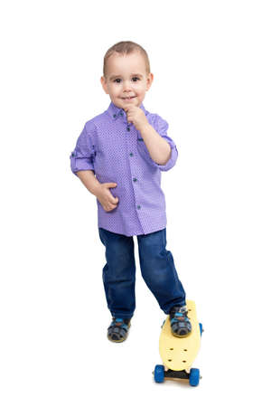 Little boy riding a skateboard isolated White background. 版權商用圖片