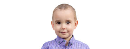 Portrait of a 2-3 year old child, copy space white background. 版權商用圖片