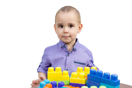 Preschool boy playing with cubes, isolated white background. 版權商用圖片