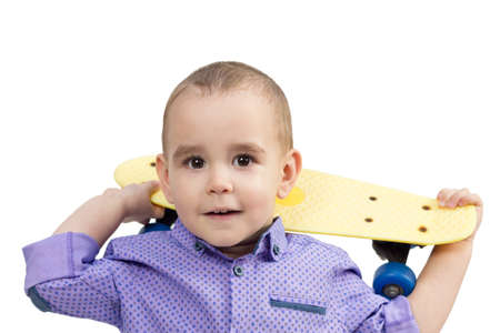 Preschool boy with skateboard on shoulder, isolated white background.