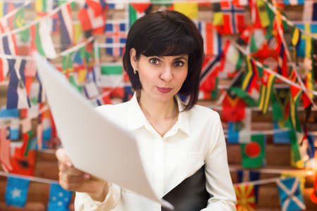 Sexy flirt pretty secretary holds out documents signature.