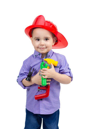 Funny boy in a helmet with a set of male tools. isolated Banque d'images