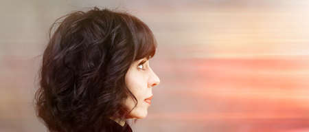 Woman looks into the distance, the concept of the future, new modern technologies.