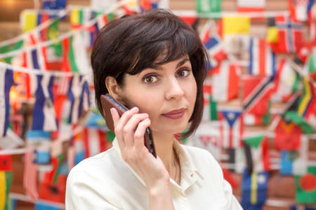Travel agency business woman talking on the phone.