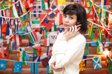 Travel agency business woman talking on phone.