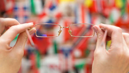 A look through the glasses at the flags of different countries.